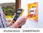 electrician technician at work...   Shutterstock . vector #1068094634