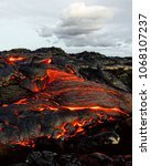 a lava flow emerges from an... | Shutterstock . vector #1068107237