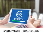 female hands holding a tablet... | Shutterstock . vector #1068108539