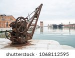 old rusty crane on an arsenal... | Shutterstock . vector #1068112595