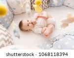 cute baby lies in a white round ... | Shutterstock . vector #1068118394
