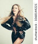 girl with long hair wears black ... | Shutterstock . vector #1068144221
