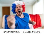 french fan celebrating at home. ... | Shutterstock . vector #1068159191