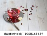 pink peony hot tea with white... | Shutterstock . vector #1068165659