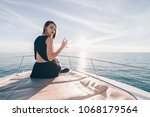 rich luxury girl rests on her... | Shutterstock . vector #1068179564
