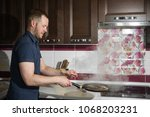 the process of cooking. man... | Shutterstock . vector #1068203231