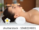 young woman lying on massage... | Shutterstock . vector #1068224831