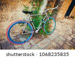 old multicolored bike on an old ... | Shutterstock . vector #1068235835