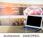 laptop on wood table blurred... | Shutterstock . vector #1068239831
