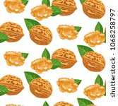seamless pattern with walnuts.... | Shutterstock .eps vector #1068258797