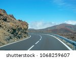 asphalt road with  landscape... | Shutterstock . vector #1068259607
