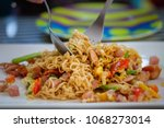 Small photo of Fried Mama or Stir Fried Noodles with ham in white Plate,Thai food