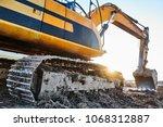 excavation work. excavator at... | Shutterstock . vector #1068312887