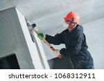 demolition work and... | Shutterstock . vector #1068312911