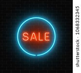 Neon Red Sale Sign In A Blue...