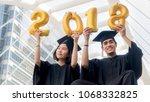 students in graduation suit sit ... | Shutterstock . vector #1068332825
