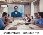 business people looking at... | Shutterstock . vector #1068334745