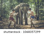 two young men in ancient... | Shutterstock . vector #1068357299