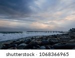 Rocks Storm And Clouds Over Th...