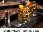 old fashioned cocktail | Shutterstock . vector #1068377537