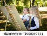 little school girls in a... | Shutterstock . vector #1068397931
