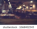 Small photo of wood table on blur of cafe, coffee shop, bar, resturant, background - can used for display or montage your products