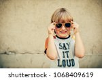 outdoor portrait of funny... | Shutterstock . vector #1068409619
