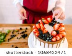 pastry chef at the wooden table ... | Shutterstock . vector #1068422471