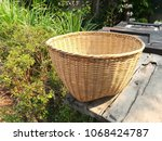 basket of thai bamboo put on... | Shutterstock . vector #1068424787