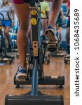spinning classes at the gym | Shutterstock . vector #1068435689