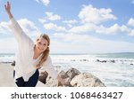 tourist woman visiting coastal... | Shutterstock . vector #1068463427