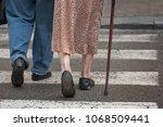 elderly couple on pedestrian... | Shutterstock . vector #1068509441