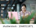 beautiful asian female student... | Shutterstock . vector #1068511871