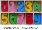 assorted painted wooden numbers ... | Shutterstock . vector #1068520364