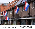 the dutch national flag hanging ... | Shutterstock . vector #1068535904