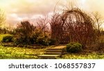steps up to  an arbour made of... | Shutterstock . vector #1068557837