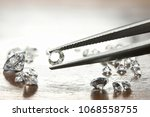 brilliant cut diamond held by... | Shutterstock . vector #1068558755