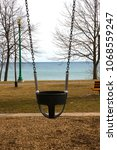 solitary swing next to big lake ... | Shutterstock . vector #1068559247