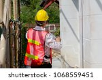 engineers are inspecting and... | Shutterstock . vector #1068559451