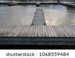 wooden marina lakeside dock... | Shutterstock . vector #1068559484