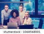 multiethnic startup business... | Shutterstock . vector #1068568001