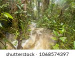 floodwater pouring through the...   Shutterstock . vector #1068574397