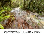 floodwater pouring through the... | Shutterstock . vector #1068574409