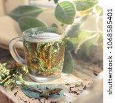 hot herbal tea with bunch of... | Shutterstock . vector #1068585401