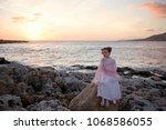 pensive sad princess girl in a... | Shutterstock . vector #1068586055