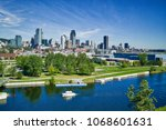 montreal skyline with yacht in... | Shutterstock . vector #1068601631