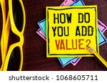 Small photo of Text sign showing How Do You Add Value Question. Conceptual photo Bring business progress contribute earn written Yellow Sticky note paper wooden background Pencil Sun Glasses.
