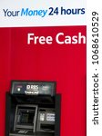 Small photo of Cash machine, Hove, England, 2018. A free cash machine outside Tesco supermarket in Hove, England.