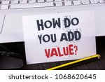 Small photo of Text sign showing How Do You Add Value Question. Conceptual photo Bring business progress contribute earn written White Sticky Note Paper placed wooden table Pencil Laoptop Mouse.