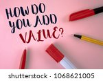 Small photo of Text sign showing How Do You Add Value Question. Conceptual photo Bring business progress contribute earn written plain Pink background Pens and Marker next to it.